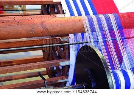 Loom Old weaving loom for making clothing.