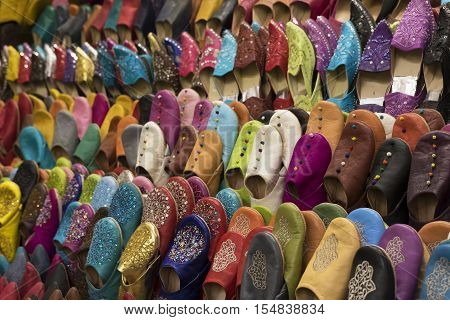 Shoes, Marrakesh Souk, Morocco / Oriental shoes hanging on the wall on the street market in Marrakesh, Morocco