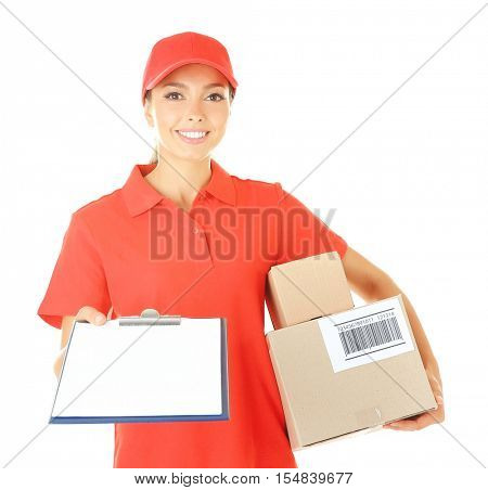 Delivery woman in uniform with clipboard and parcels on white background