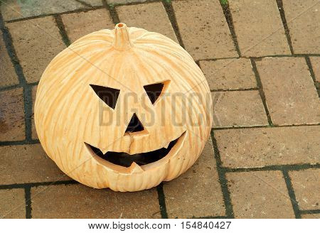 A pumpkin face for showing the concept of Halloween