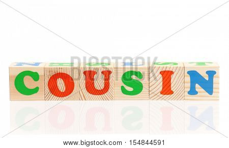 Cousin word formed by colorful wooden alphabet blocks, isolated on white background