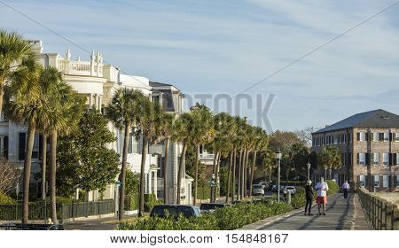 Pedestrians and rowhouses on East Bay Street in historic Charleston, South Carolina
