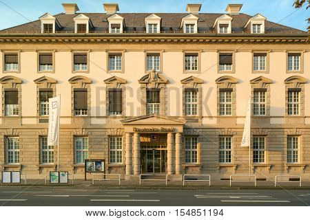 Deutsche Bank branch: facade of an old classical building with the logo of German global banking and financial services company, entrance view. Heidelberg, Germany - November 1 2016.