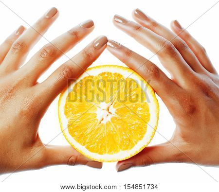 manicure on afro-american tan skin hands holding orange, healthcare concept close up