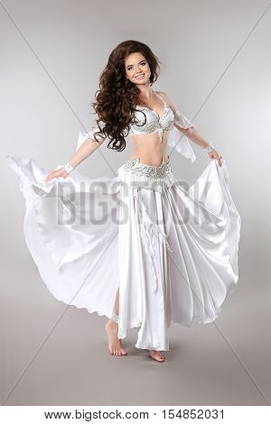Belly Dance. Bellydancer. Beautiful Brunette Gorgeous Arabian Woman Dancer With Long Curly Hair Posi