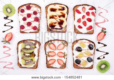 Healthy Eating. Sweet Sandwiches With Cream Cheese And Fresh Berries And Fruit On White Background.