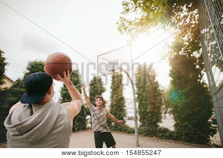Streetball Players On Court Playing Basketball.