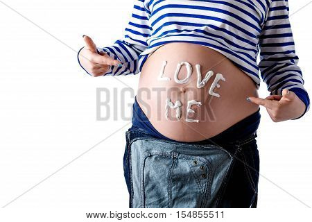 Pregnant woman writing 'love me' word on her belly. Isolate.