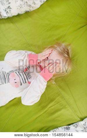 Little Toddler Girl In Bed On Sunny Morning