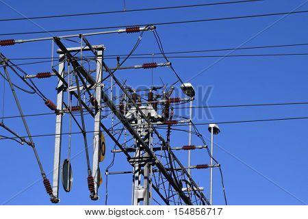 There are many electricity wires in the blue sky