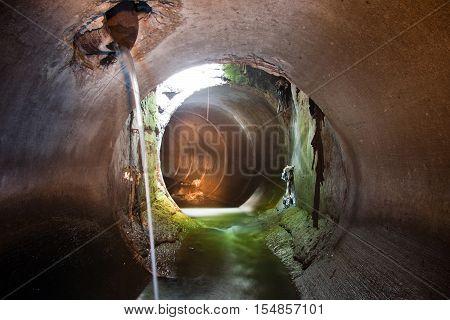 Sewer tunnel, underground river under