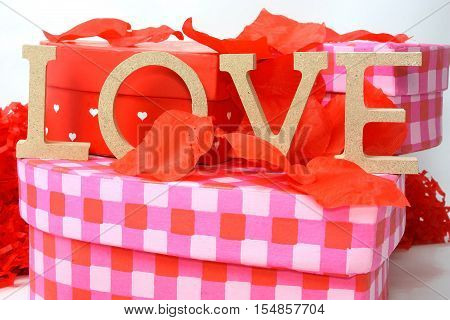 The concept of Valentines day with heart shaped gift boxes and words of love