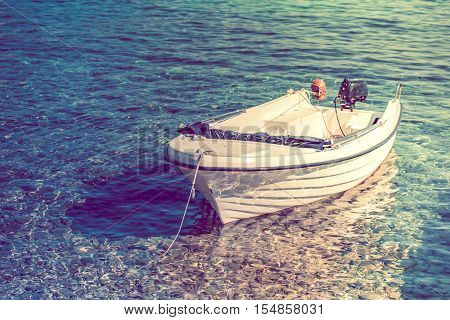 Compact Fishing Motorboat on the Crystal Clear Water