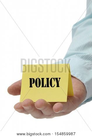 Business man holding yellow policy sign on hand