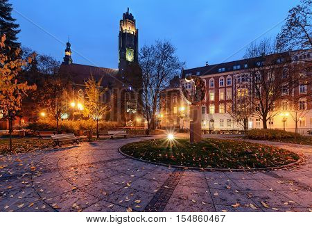 Autumn square near the Church of All Saints in Gliwice. Europe.