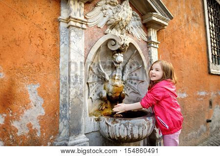 Little Girl Playing With Drinking Water Fountain