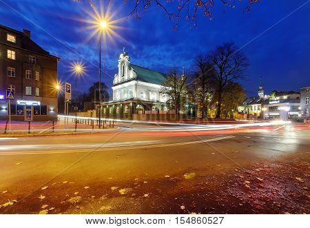 The street and the church in Gliwice Poland in the evening.