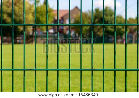 Green Fence And Houses
