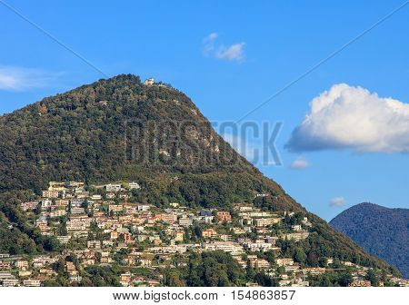 Mountain Monte Bre, view from the city of Lugano in autumn. Monte Bre is a 925m high mountain east of Lugano, which is the largest city of the Swiss canton of Ticino.