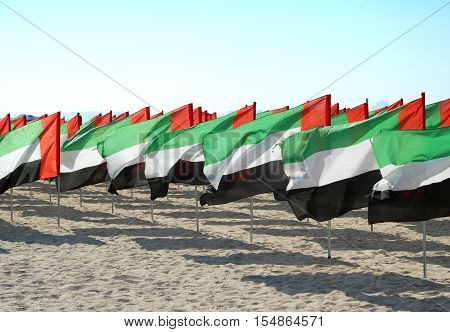 Lots of flags of the United Arab Emirates for the anniversary celebration. UAE Natoinal day. Emirates Flag. UAE celebrates National Day on 2nd December every year.