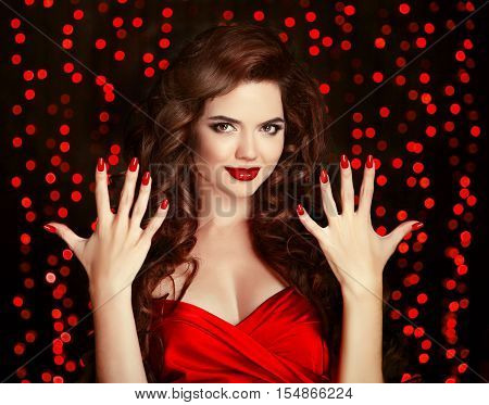 Red Manicured Nails. Elegant Brunette. Beautiful Smiling Girl With Healthy Curly Hair Style And Lips