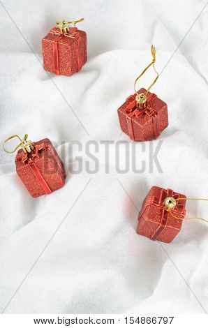 Christmas Baubles on snow white background