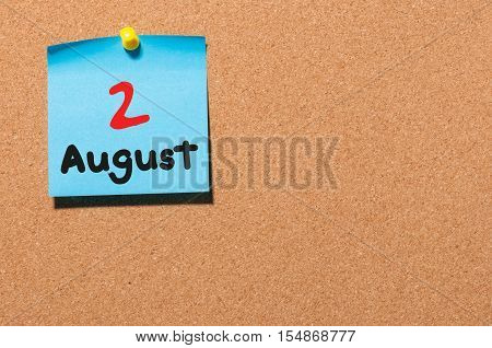 August 2nd. Day 2 of month, color sticker calendar on notice board. Summer time. Close up.