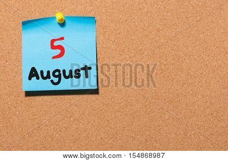 August 5th. Day 5 of month, color sticker calendar on notice board. Summer time. Empty space for text.