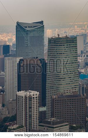 Tokyo Japan - September 26 2016: Aerial view since shot off Observatory tower. Portrait of the Mori towers surrounded by a multitude of highrise buildings in the late afternoon.