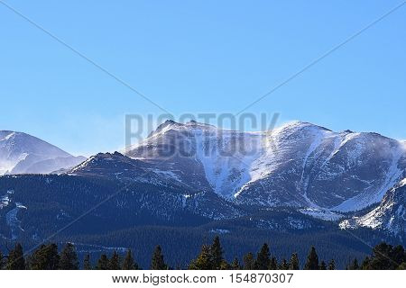 The snow blowing off of Pikes Peak in Colorado.