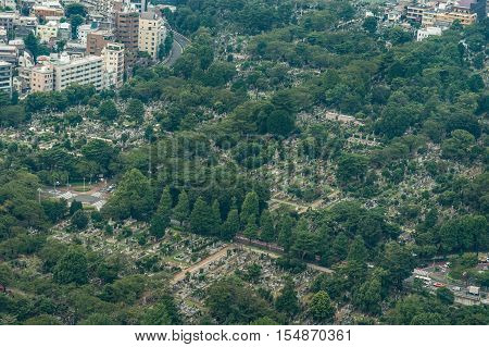 Tokyo Japan - September 26 2016: Aerial view since shot off Observatory tower. The Aoyami Buddhist cemetery offers a green oasis in the concrete jungle of downtown Kyoto.