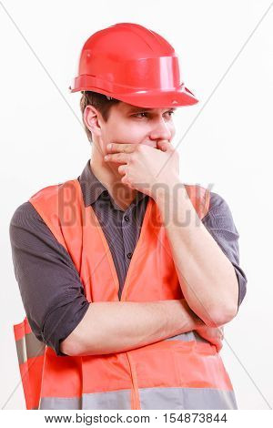 Job and work concept. Young handsome smiling worker wearing safety vest and hard hat. Repairman inspector isolated on white.