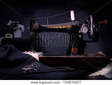 Classic retro style manual sewing machine ready for sewing work.