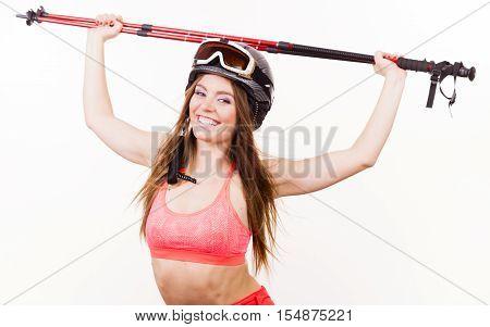 Woman Lifting Skiing Poles.