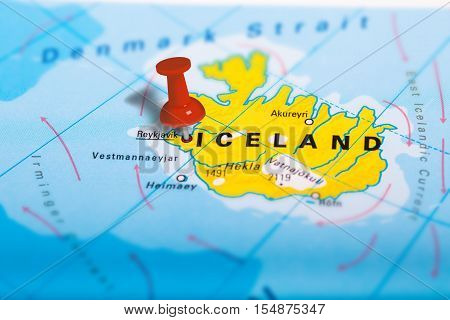 Reykjavik in Iceland pinned on colorful political map of Europe. Geopolitical school atlas. Tilt shift effect.