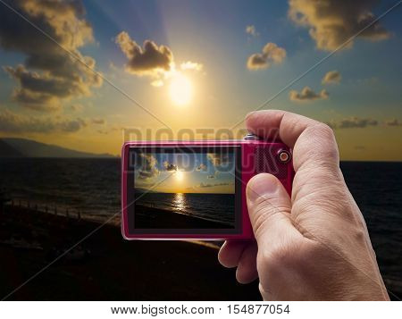 Evening sunset on sea in camera viewfinder