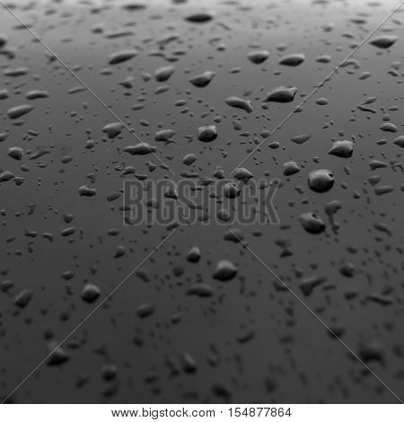 Raindrops on the surface with a glossy appearance focus of Selection. poster