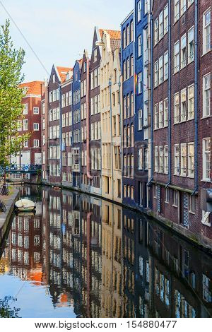 Delft city view with canals in Holland