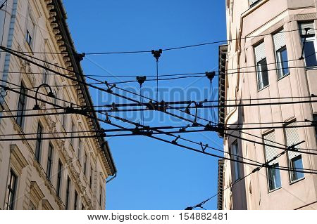 Tram wires spoil the appearance of the houses in the urban landscape