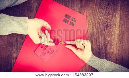People Exchanging House Keys.