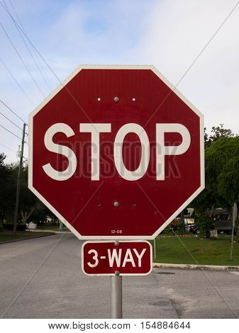3-Way Stop Sign in a residential area in Lake Wales Florida