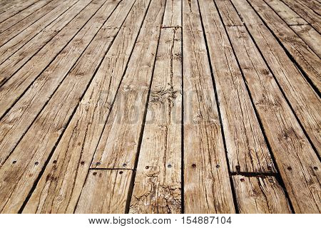 Closeup of wooden planks of fence boardwalk texture background. Vertical diagonal lines