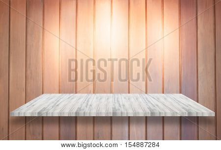 Top of white wooden shelf with spot light on wooden wall background, stock photo