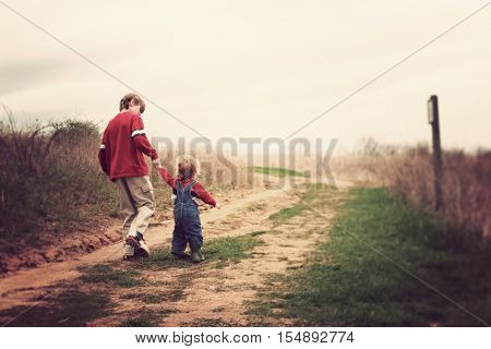 Two brothers walking up a hill