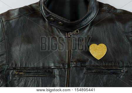 Heart of gold on old black leather jacket