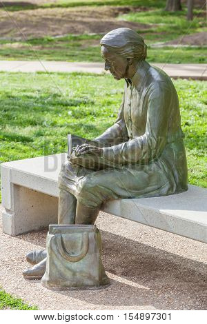 Springfiled Missouri USA- May 18 2014. Reading woman statue in Nathanael greene park Springfield Missouri.