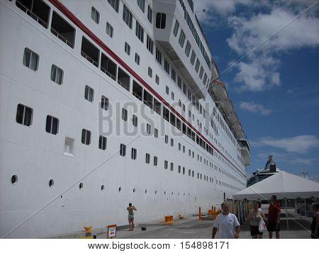 Longitudinal view of cruise ship at dock