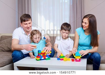 Family playing game together at home. Happy family.