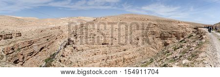 Large panoramic view of the Kidron Valley, a river canyon in Judean desert. Israel