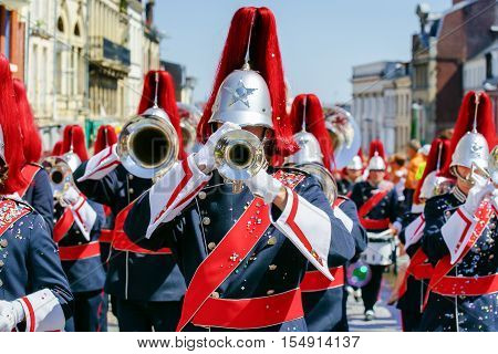 Close up and details of playing musicians instruments in a marching show band or music band